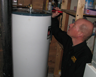 Chris Franks Certifed Home Inspector Inspecting Hot Water Tank pic